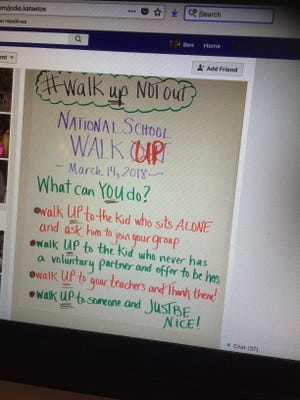 "A teacher in Accomack County wrote a message on a poster board in her classroom reading, ""Walk Up Not Out."" a day before students on Delmarva and across the country participated in National Walk Out Day to show solidarity and honor the 17 killed in the Valentine's Day attack at Marjory Stoneman Douglas High School in Parkland, Fla. An image of the board the teacher posted on her Facebook page has since gone viral."