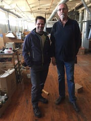 Sig Strautmanis (left), a partner at General Capital Group LLP, and Dan Baughman, owner of Bergamot Brass Works Inc., at the Bergamot building in Delavan. General Capital is buying the building from Bergamot and will redevelop it into affordable apartments.