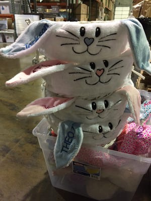 Stacks of bunny Easter baskets awaiting personalization at Dibsies.