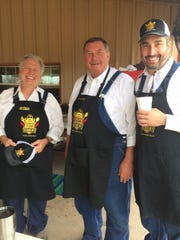 Jim Heiman, left, Wichita County Commissioner Lee Harvey and Tony Fidelity of the Redneck Culinary Society did a lot of the cooking for the Semper Gratus Helicopter Hog Hunt.
