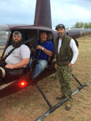 Mike Burress, right, founder of Semper Gratus with first Helicopter flight Friday morning. The annual hog hunt, held in Truscott, Texas, brings Wounded Warriors together for a weekend of hunting and camaraderie.