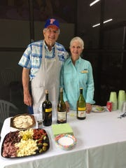 Tom and Judy Schulte tend bar at the appreciation party.