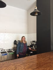 Debbie Blissick stands behind the counter in the front room of Cup of Bliss Coffee Company in Collingswood, just before her  May opening. Blissick is committed to using compostable cups and other items in her shop to avoid single-use plastics.