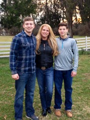 Rachel McAuley poses with her sons Grant, left, and