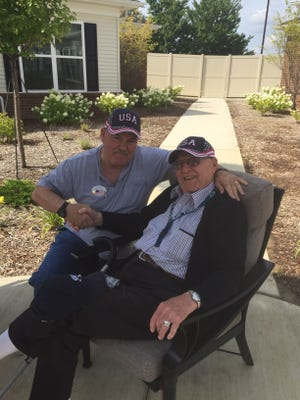 Sean Tracy with George Lusko. Lusko, 100, served on an anti-aircraft ship in the South Pacific.