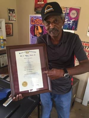 """Guitarist Paul """"Lil Buck"""" Sinegal shows off his Louisiana Hall of Fame induction certificate."""