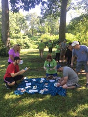 A team sorts clues, enjoying the Somerset County parks