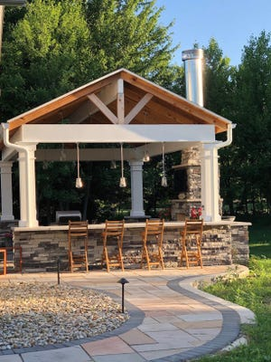 Dan Merriss, 62 and Liz Merriss, 54, began working on a pavilion at their Powell home last winter. The project was finished this spring -- perfect timing for a staycation, Liz Merriss said. The couple furnished the structure with some online shopping and some furniture they already had.