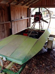 This is the 23-horsepower airboat Jimmy Hayes built with plastic and plywood and white oak ribbing.