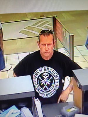 Police are searching for the man who robbed a Cocoa bank in a Sons of Anarchy t-shirt.