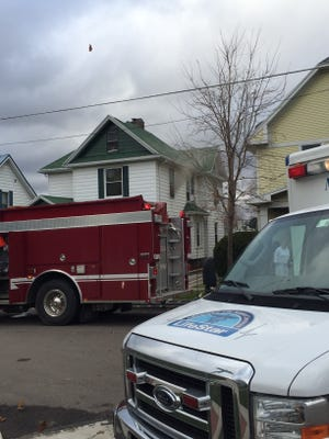 Smoke spills out of a upstairs room at 322 W. Charles St., Bucyrus, Monday afternoon.