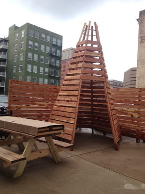 The patio at Cheapside includes a wooden construction with a table inside where you can hide and drink coffee, eat a sandwich or breakfast.