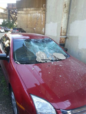 Andy Brothers took this photo of his 2008 Ford Fusion after it was hit by concrete falling off a ramp to the Brent Spence Bridge.