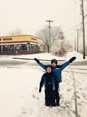 Hayden (in back with arms up) and Elijah Reynolds took a walk to Waffle House in Hamilton with their mother Tricia Reynolds Monday morning.