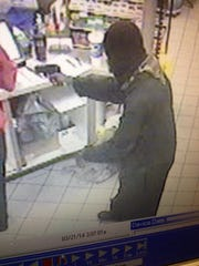 Surveillance photo of a robbery suspect in a Bonita Springs Circle K robbery