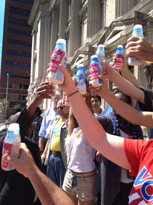 Environmentalists toast with milk IPL decision to switch to natural gas at Harding Street plant.