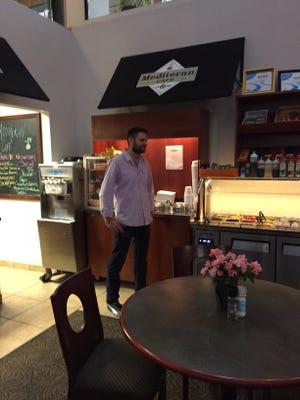 Owner Igor Jurkovic inside Mediteran Café & Catering.