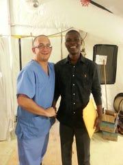 USPHS Lt. Chris Snyder developed a friendship with Ebola survivor Alvin Davis while stationed in Monrovia, Liberia.