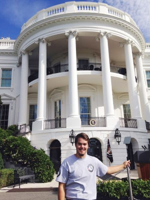 Spencer Varner poses in front of the White House.
