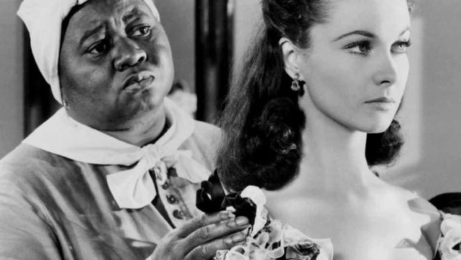 "Two Oscar-winners: Hattie McDaniel is ""Mammy"" and Vivien Leigh is ""Scarlett"" in ""Gone with the Wind."""