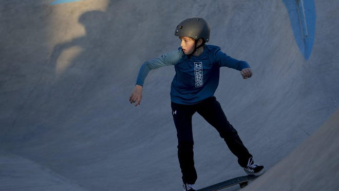 Tripp Johnston skates at Pierce Park in December in Taylor. The skatepark will remain closed for now.
