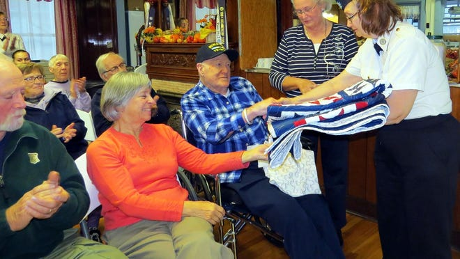 "World War II veteran Robert ""Buster"" Lewis, seated, receives a Quilts of Honor quilt last November in Oxford from Brenda Crandall and a handshake from Fort Hill American Legion Post commander Darlene Ardron, far right. To suggest a veteran or help with a donation for the outreach, call Trish Kane at 607-674-9656."