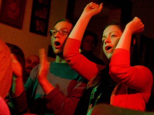 Jordan Marx (left) and Rachel Pinkstone, both of Collingswood, attend a Cordero performance at the home of Jen Hilinski and Dave Khanlian in 2010.