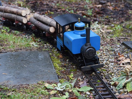 One of the trains Thomas Murphy uses on his garden railway in the backyard of his Hyde Park home. This one actually runs on steam produced by butane fuel.