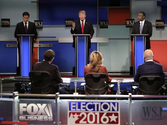 Republican presidential candidates Marco Rubio (L), Donald Trump (C) and Ben Carson (R) participate in the Republican Presidential Debate hosted by Fox Business and The Wall Street Journal November 10, 2015 in Milwaukee, Wisconsin.