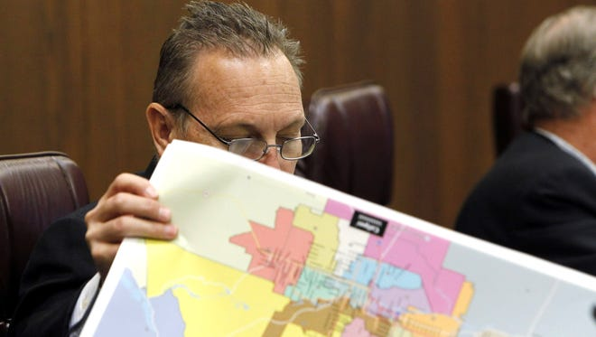 A Republican state legislator reviews proposed district maps in 2011, the year before an independent commission completed them.