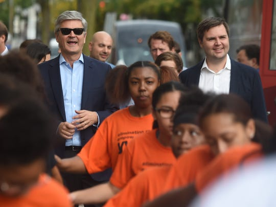 Steve Case, left, along with J.D. Vance, get escorted from their bus to the Fortress Academy by the Temple Guard Drill Team in York on Tuesday, Oct. 10, 2017, during the Rise of the Rest tour. The purpose of the tour is to bring attention to startups in areas of the country that don't get a lot of attention from venture capitalists.