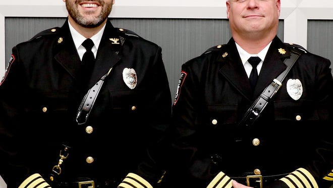 Sturgis Public Safety Director Ryan Banaszak and deputy director of public safety Andrew Strudwick pose Wednesday in their dress uniforms with their new badges. The badges were imprinted with their new positions as a result of recent promotions.