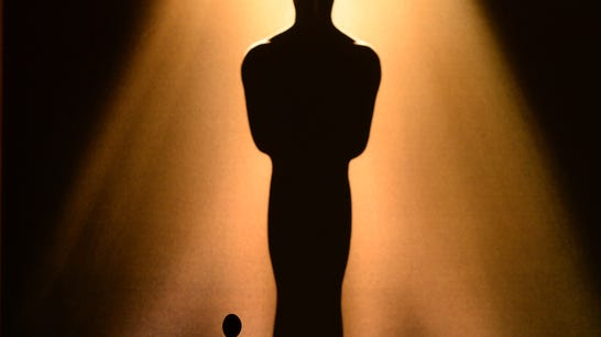 An image of an Oscar statuette is seen in the background.
