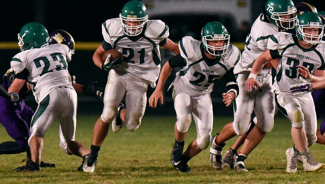 Holdingford's offensive line creates a large hole for Nolan Prokott to run against Melrose.