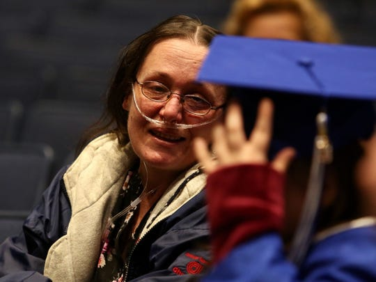 Verena Shiflett of Hamilton gazes at her daughter Rhonda who received a diploma from Hamilton High School in a special ceremony Feb. 22. Shiflett, who is in hospice care for a lung disorder, told a social worker that her dream was to see Rhonda graduate from high school.