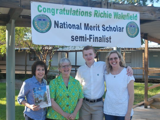 (From left) Grace Christian School's guidance counselor Marian Deville and Principal Kay Blackburn pose with Richie Wakefield and his mom Terry Wakefield.