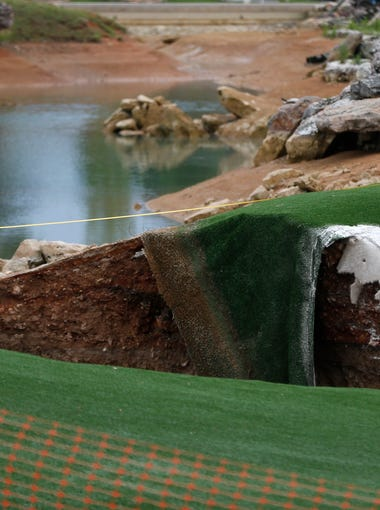 A large sinkhole opened up between the driving range and putting green at Top of the Rock golf course in Branson on Friday, May 22, 2015.