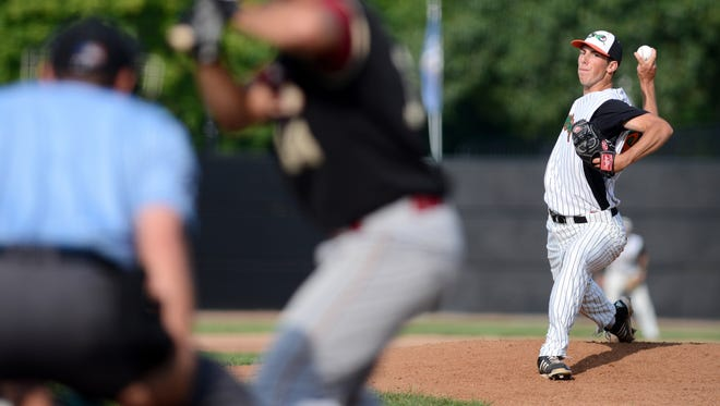 Justin Mullins pitches to a Wisconsin Rapids Rafters batter during the Green Bay Bullfrogs final game of the season at Joannes Stadium in Green Bay Wis. on Sunday, Aug. 10, 2014.