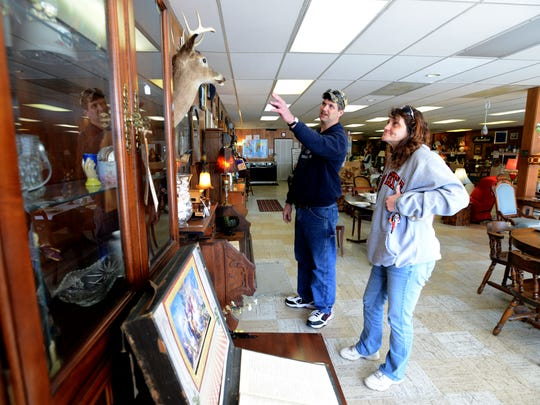 Donald Shipley, left, and Bobbie Friend shop at For Goodness Sake in Lancaster. The store is run by Cross Pointe Free Will Baptist Church, which was recently hit with a botulism outbreak.