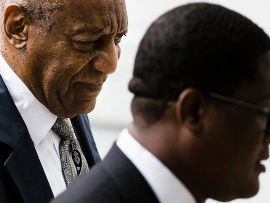 Bill Cosby, left, accompanied by Andrew Wyatt arrives