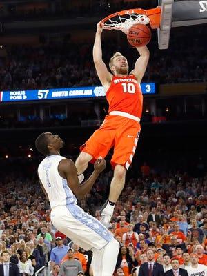 Syracuse guard Trevor Cooney (10) dunks against North Carolina forward Theo Pinson (1)