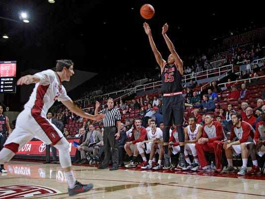 Utah guard Lorenzo Bonam (15) shoots over Stanford forward Rosco Allen, left, during the first half of an NCAA college basketball game Friday, Jan. 1, 2016, in Stanford, Calif. (AP Photo/Marcio Jose Sanchez)