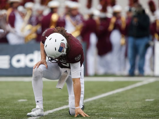 Peyton Huslig kneels after throwing an interception during the Bears 25-10 loss to Northern Iowa at Plaster Stadium on Saturday, Nov. 11, 2017.