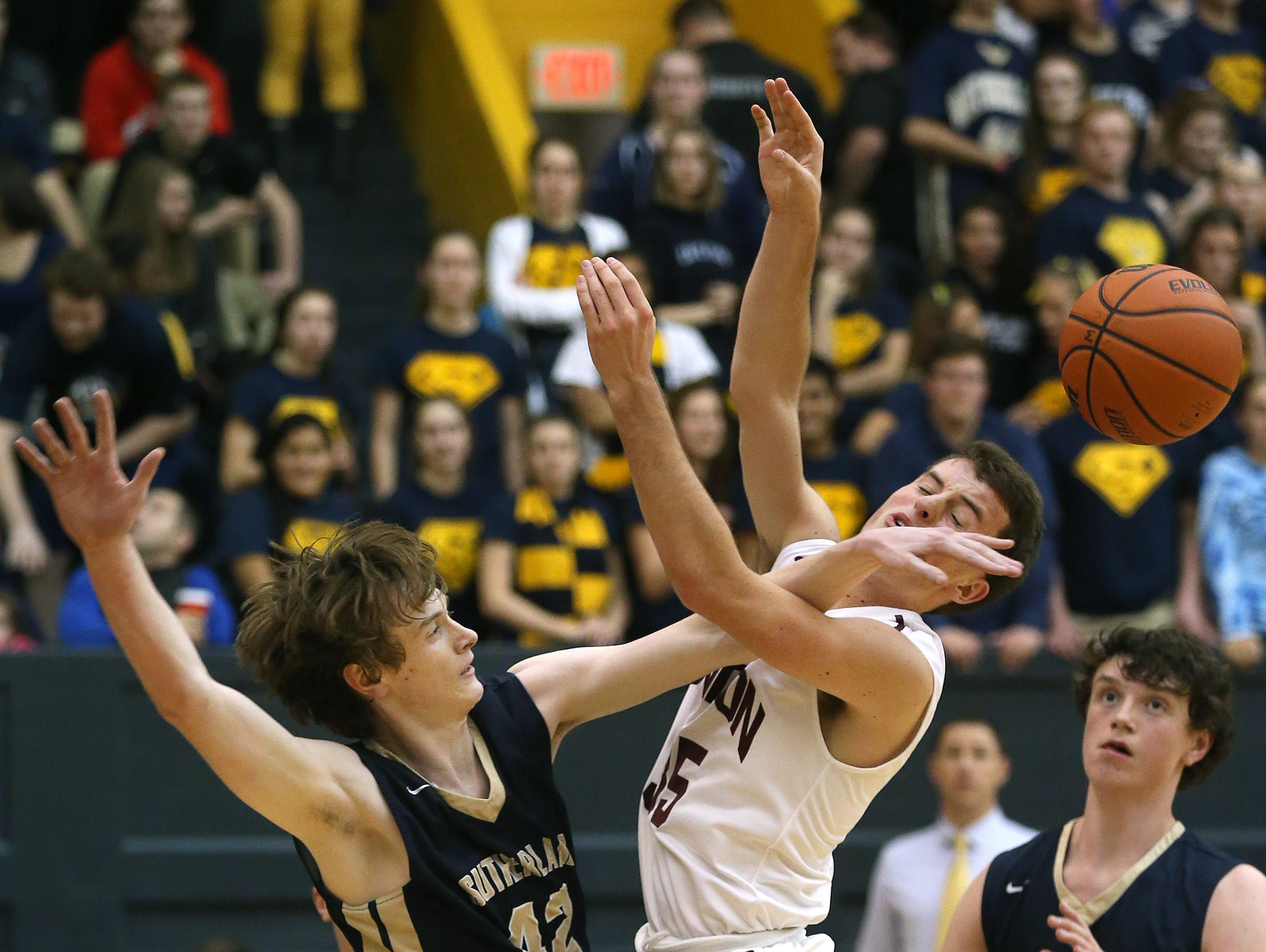 Mendon's Matt Powers gets a hand in the face by Sutherland's Mike Ryan while trying to get a shot off during the Rainbow Classic.