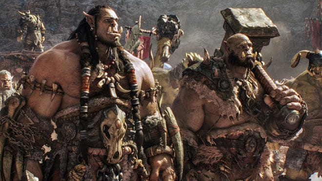"""This image released by Universal Pictures shows characters Orc chieftain Durotan, voiced by Toby Kebbell, left, and Orgrim, voiced by Rob Kazinsky, in a scene from the film, """"Warcraft,"""" based on the Blizzard Entertainment video game."""