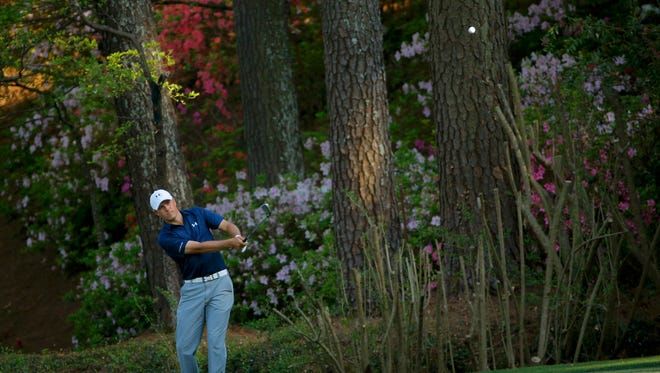 U.S. golfer Jordan Spieth chips onto the 13th green during the third round of the Masters golf tournament at the Augusta National Golf Club in Augusta, Georgia April 12, 2014.