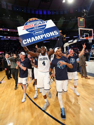 The Villanova Wildcats celebrate after beating the Providence Friars to win the 2018 Big East Championship at Madison Square Garden.