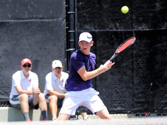 Wylie's Davyn Williford watches his shot during the