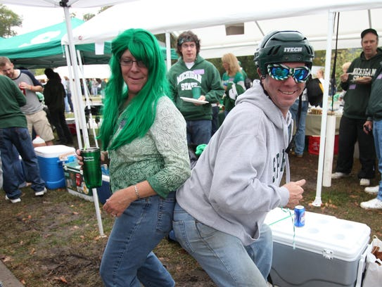 Two Michigan State fans dance their hearts out as they