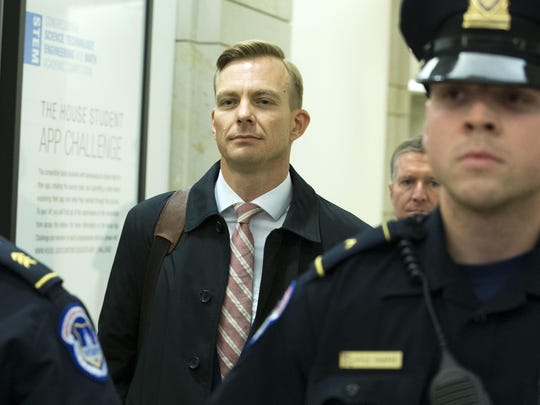 David Holmes, a career diplomat and the political counselor at the U.S. Embassy in Ukaine leaves the Capitol Hill, Friday, Nov. 15, 2019, in Washington, after a deposition before congressional lawmakers as part of the House impeachment inquiry into President Donald Trump. (AP Photo/Jose Luis Magana)